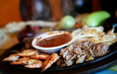 Grilled steak, shrimp, chicken, pork and chorizo sausage served with two salads, rice, beans and tortillas. $24.99